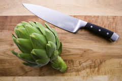 Artichoke and Knife Royalty Free Stock Images