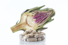 Artichoke leaf extract capsules. tablets, and ampoules. Artichoke leaf extract capsules. and Dietary supplements Royalty Free Stock Photo