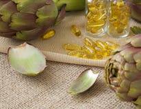 Artichoke oil softgels. On a sackcloth royalty free stock photo
