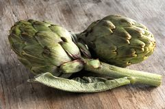 Artichoke on old kitchen table Stock Image