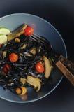 Artichoke pasta. Squid ink pasta with artichoke Royalty Free Stock Photos