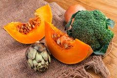 Artichoke, sliced pumpkin, onion and broccoli Stock Photo