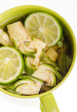 Artichoke slices. In water and lime juice- preventing oxidation Royalty Free Stock Images