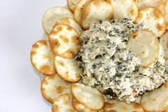 Artichoke and spinach dip with pita bread chips. A plate with artichoke and cheese dip with pita bread chips royalty free stock images