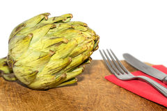 Artichoke on a table Stock Images