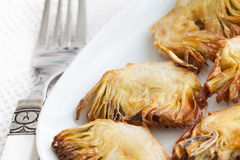 Artichoke tapas. Fried artichoke tapas with white background Stock Photos