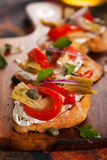 Artichoke Toasts. With grilled red pepper Stock Images