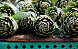 Artichoke vegetable close up, Background of fresh artichokes. Mediterranean vegetable. Maltese vegetable. In street market Stock Images