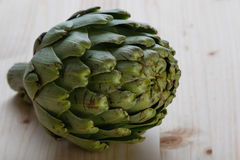 Artichoke on wooden table Royalty Free Stock Photos
