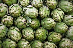 Artichokes. Macro view of artichokes in market Stock Image