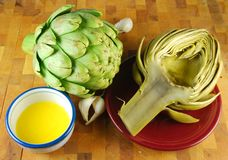 Artichokes And Butter Stock Photo