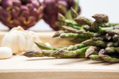 Artichokes, asparagus stems and garlic Royalty Free Stock Image