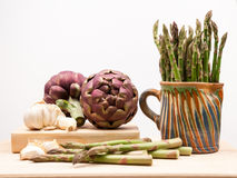 Artichokes, asparagus stems and garlic Stock Image