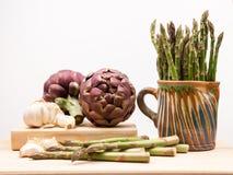 Artichokes, asparagus stems and garlic Stock Image