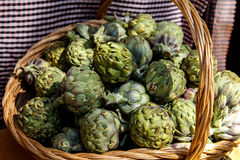 Artichokes in basket Royalty Free Stock Photos