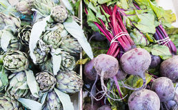 Artichokes and beets in a market in Paris, France Royalty Free Stock Photos