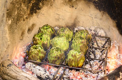 artichokes being grilled Stock Photos