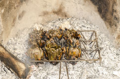 artichokes being grilled Royalty Free Stock Images