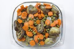 Artichokes and carrots cooked Stock Photos