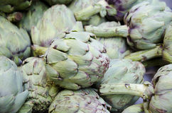 Artichokes. Fresh artichokes for sale in the outdoor farm market stock photography