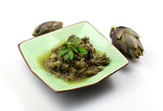 Artichokes with garlic and parsely Royalty Free Stock Photography