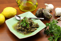Artichokes with garlic and parsely Stock Photos