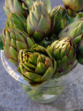 Artichokes. In a glass pot Stock Photos