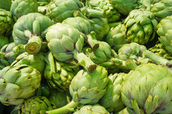 Artichokes on the market. Pile of fresh green artichokes at a market stall Royalty Free Stock Photo