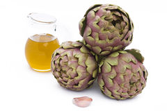 Artichokes, Olive Oil And Garlic Stock Images