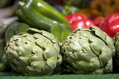 Artichokes and peppers Stock Images