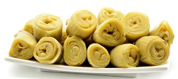 Artichokes plate. Canned artichokes in a plate surrounded by white background Stock Images