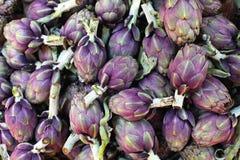 Artichokes. Purple artichokes at farmers market Stock Photos