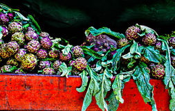 Artichokes on a red car Royalty Free Stock Photography