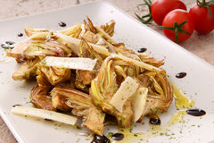 Artichokes salad with parmigiano cheese Stock Images