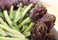 Artichokes for sale in stand of greengrocers Stock Photo
