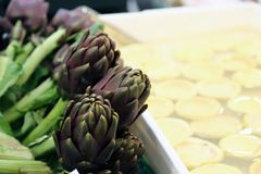 Artichokes for sale in stand of greengrocers to local market Royalty Free Stock Photo