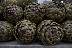 Artichokes. Some artichokes on a fresh vegetables bank market Royalty Free Stock Images