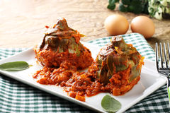 Artichokes with tomato sauce and omelette Stock Image