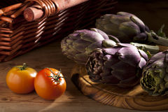 Artichokes and Tomatoes Stock Images