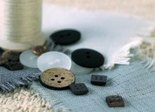Daily Article. Sewing supplies, buttons, thread, fabric swatches stock photo