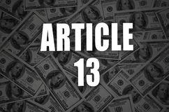 Article 13 inscription and many hundred dollar bills in dark background royalty free stock image