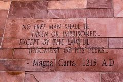 Article of Magna Carta text. On of the old brick wall royalty free stock images