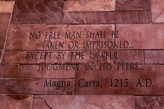 Article of Magna Carta text. On of the old brick wall stock image