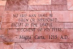 Article of Magna Carta text. On of the old brick wall Stock Photo
