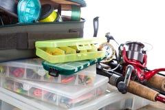 Articles de pêche et amorces dans la boîte Photographie stock libre de droits