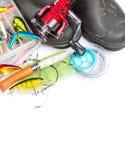 Articles de pêche et bottes en caoutchouc sur le blanc Photos libres de droits