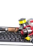 Articles de pêche sur le clavier d'ordinateur Images libres de droits