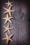 Articles marins sur le fond en bois Images libres de droits