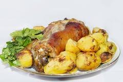Articolazione della carne di maiale al forno con le patate Fotografie Stock Libere da Diritti