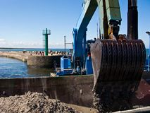 Dredger ship at work in Baltic port entrance Stock Photo